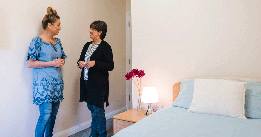 Salus Withnell: an image of the inside of a room in our detox unit, with two staff in conversation